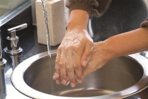 Photo of person washing their hands